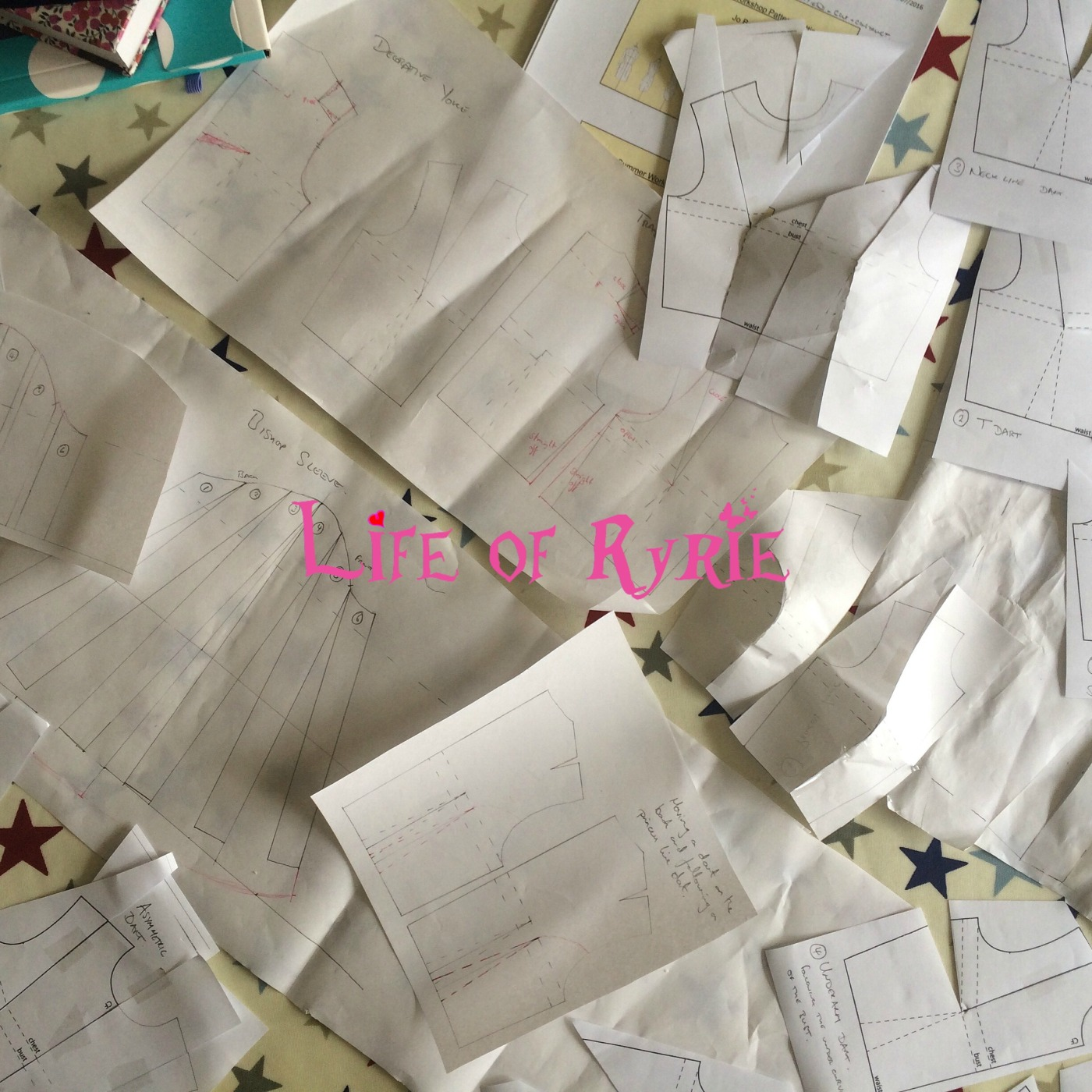 paper garment patterns scattered across a table